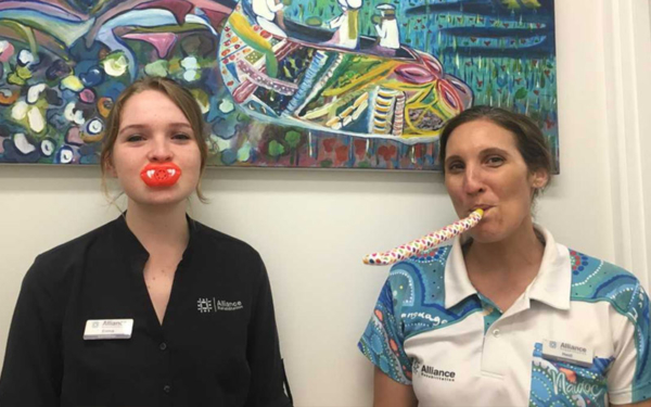 Two staff members with speech therapy toys