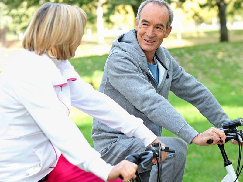 Elderly couple riding bicycles