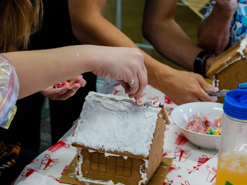 People making gingerbread houses as a therapy exercise