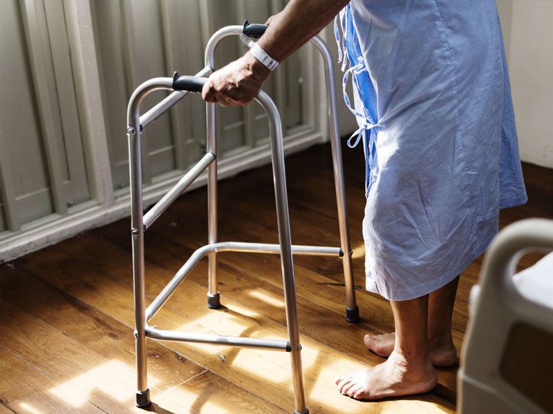 closeup of man using walking frame