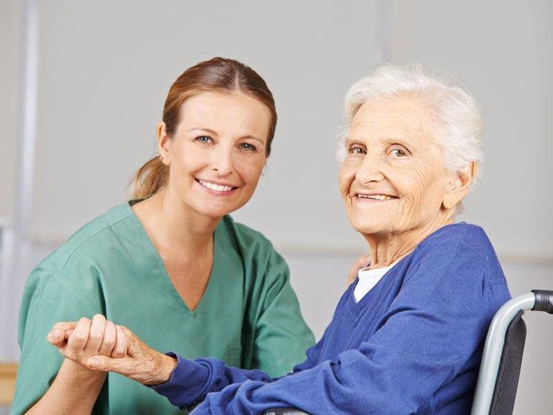 Stroke Rehabilitation nurse holding elderly womans hand