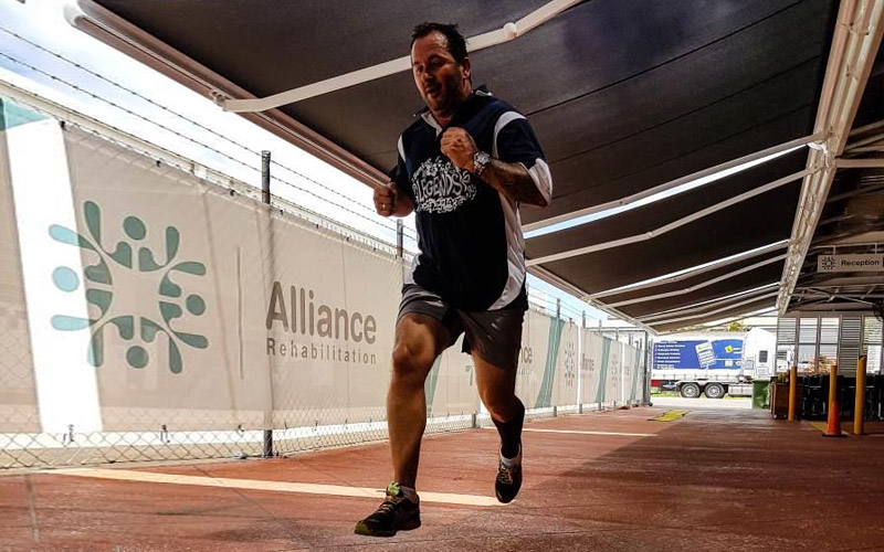 Man running while in rehabilitation at Alliance Rehabilitation