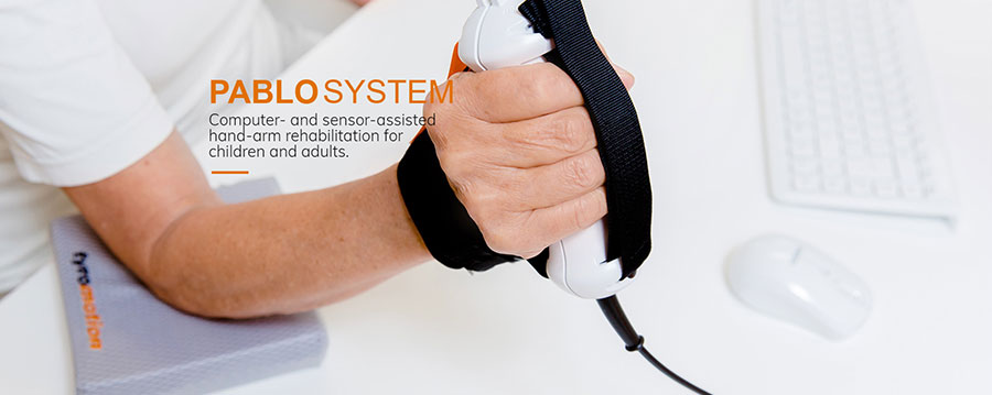 Man holding Pablo hand-arm rehabilitation device