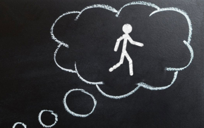 chalk drawing of a thought bubble with stick-figure walking