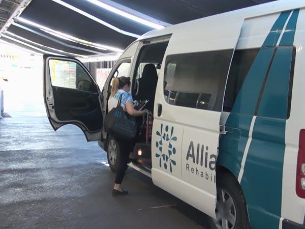 Team member loading van in Townsville